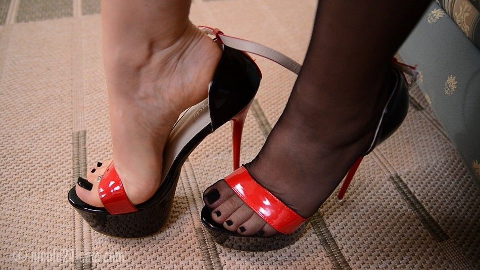 Redhead Does A Footjob In Sexy Heels